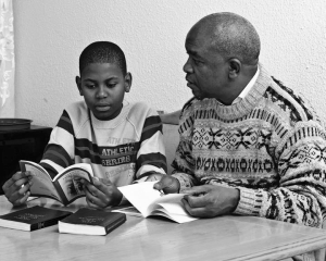 Photo of a man reading with a child. Flickr Creative Commons image from: More Good Foundation: https://flic.kr/p/aqDAUE