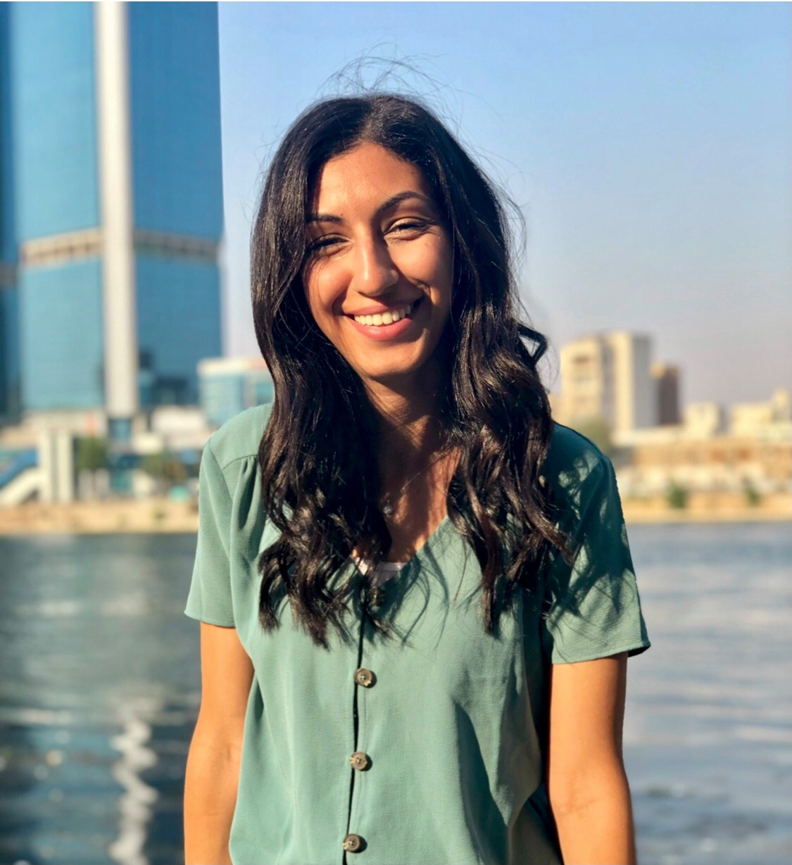 A woman in a green shirt smiling